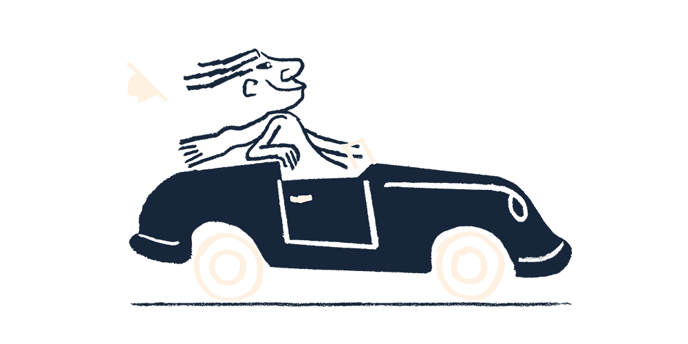 A man driving a car with the wind in his hair